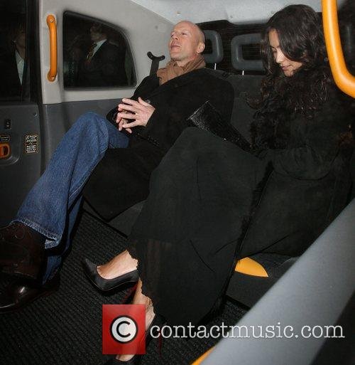 Bruce Willis, His New Girlfriend Emma Heming Arrive Back At Their Hotel and Having Had Had Dinner At The Ivy Restaurant. 3