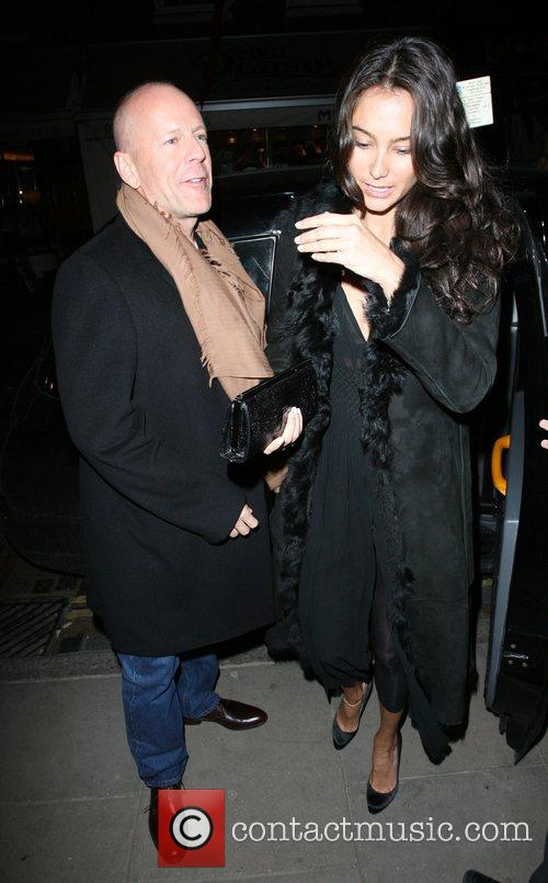 Bruce Willis, His New Girlfriend Emma Heming Arrive Back At Their Hotel and Having Had Had Dinner At The Ivy Restaurant. 10
