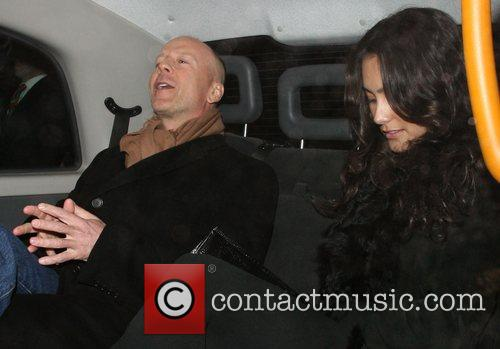 Bruce Willis, His New Girlfriend Emma Heming Arrive Back At Their Hotel and Having Had Had Dinner At The Ivy Restaurant. 8