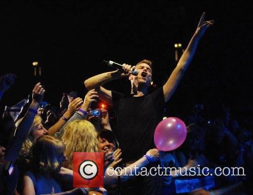 Bryan Adams performing live at the Wembley Arena