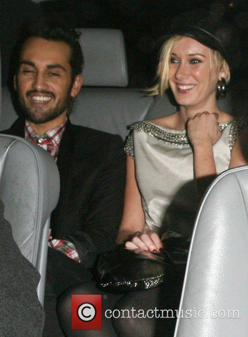 Kimberly Stewart with a male companion,  leaving...