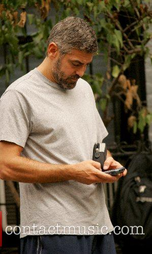 George Clooney takes a break to send a...