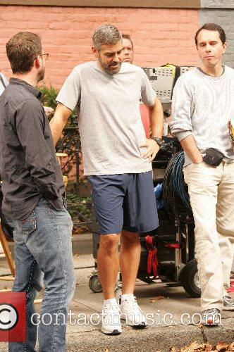 George Clooney takes a break from filming a...