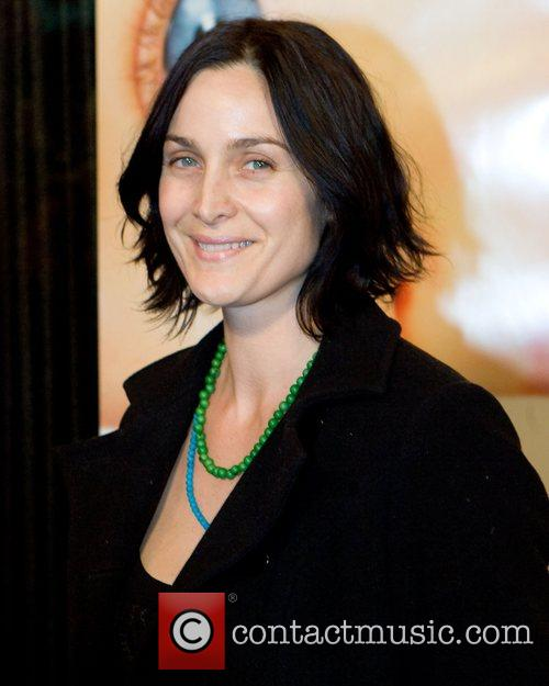 Carrie Anne Moss,  Premiere of 'The Business...