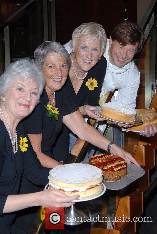 Angela Baker, Tricia Stewart and Lynda Loganpose The...