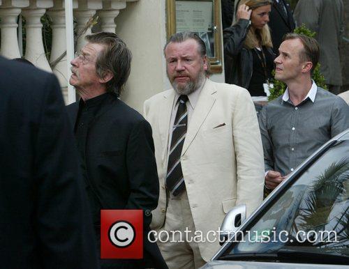 John Hurt and Ray Winstone walk along the...