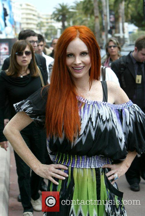 Phoebe Price walks along the Croisette during day...