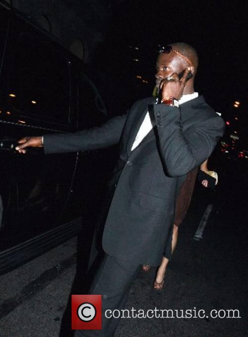 Djimon Hounsou leaving the Cocktail party in celebration...