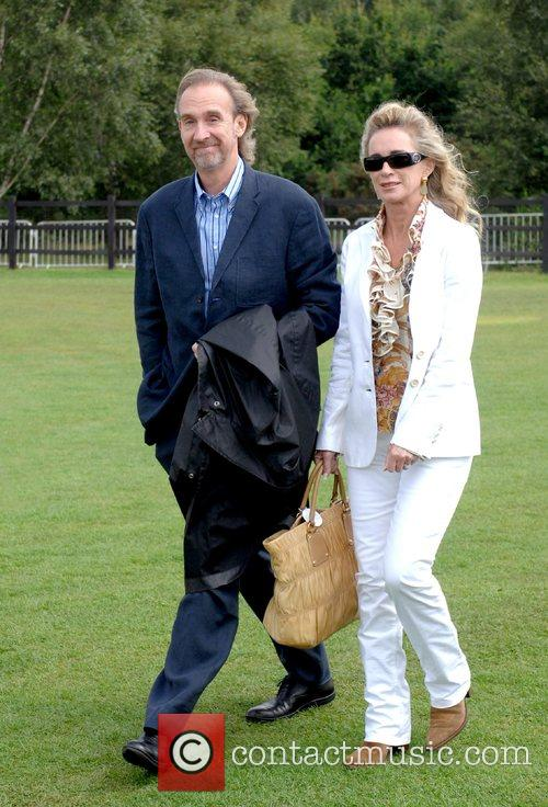 Mike Rutherford and guest Cartier International Polo Guards...