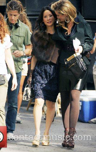 Lucy Liu and Bonnie Somerville on the set...