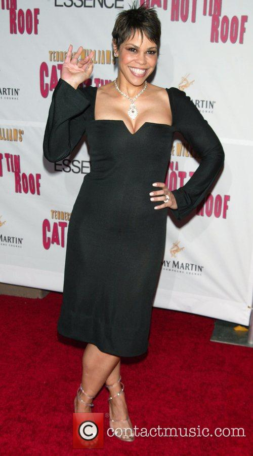 April Woodard at the arrivals for the Opening...