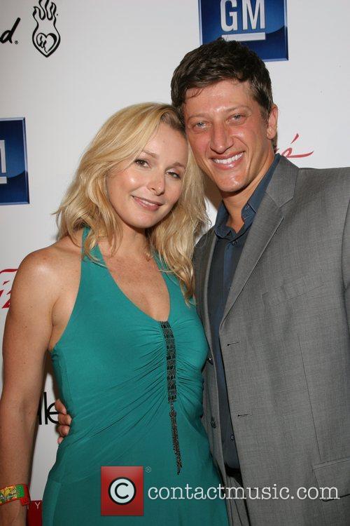 Elle Travis and Josh Feinman Celebrity Catwalk for...