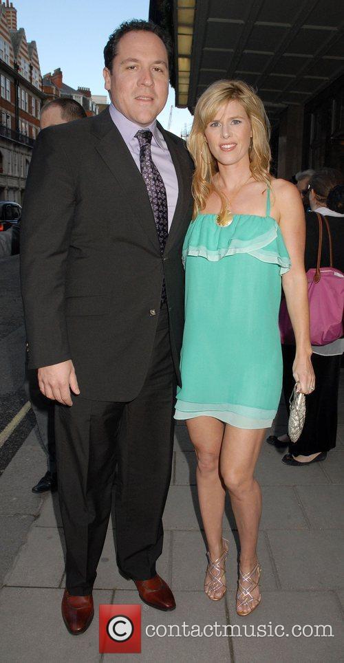 Jon Favreau and his wife Joya Tillem leaving...