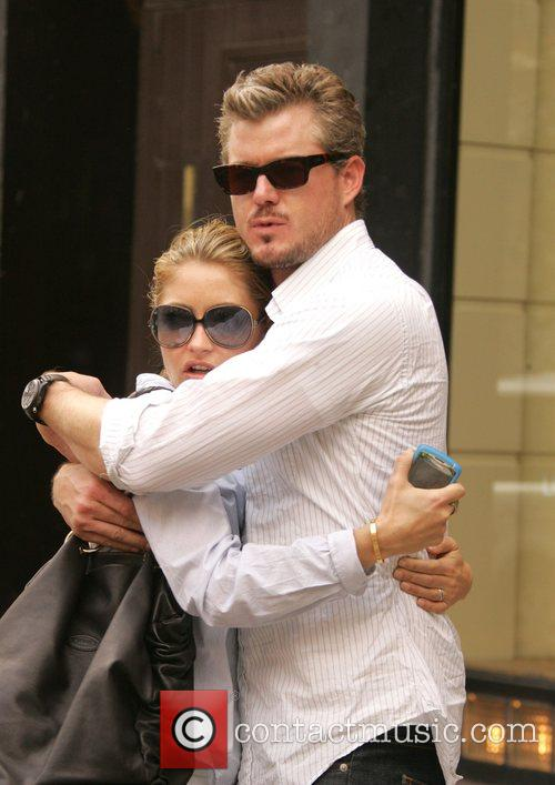 Eric Danes and Rebecca Gayheart cuddle each other...