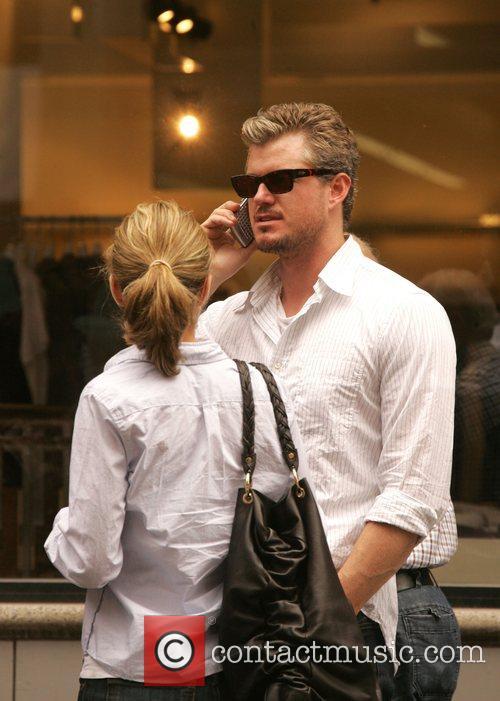 Eric Danes and Rebecca Gayheart walking through SoHo...