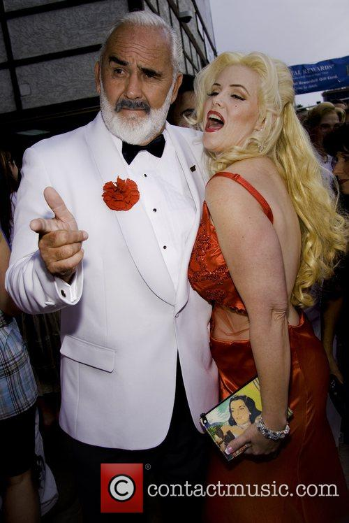 John Allen (Sean Connery impersonator) and Dawnn Behrens...