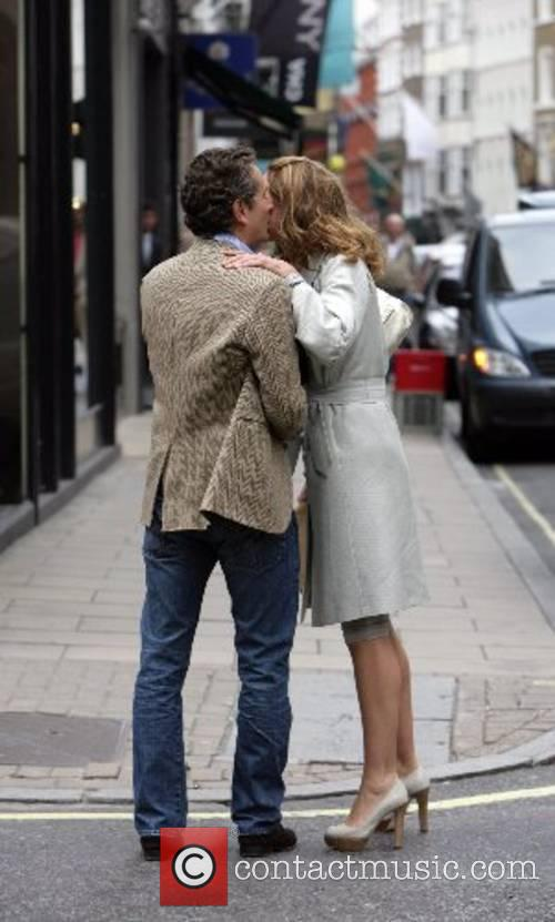 Trinny Woodall greets a male friend with a...