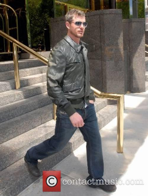Leaving his hotel in Manhattan