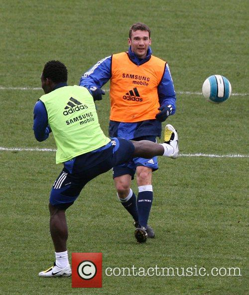 Andrei Shevchenko and Michael Essien during a Chelsea...