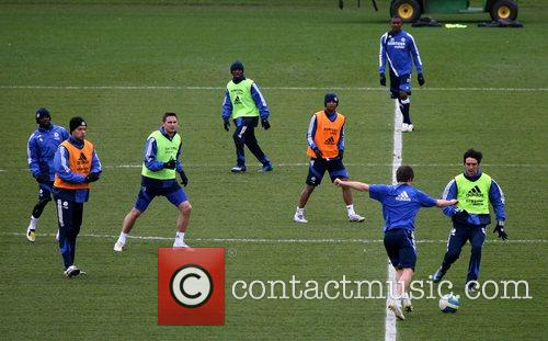 Chelsea Football Club endure a gruelling training session,...