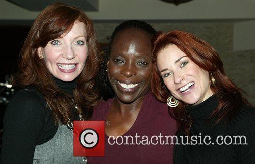 Michelle DeJean, Michelle Robinson and Michelle Potterf celebrating...