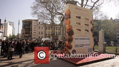 Crowds gather around a large chocolate box Thorntons...