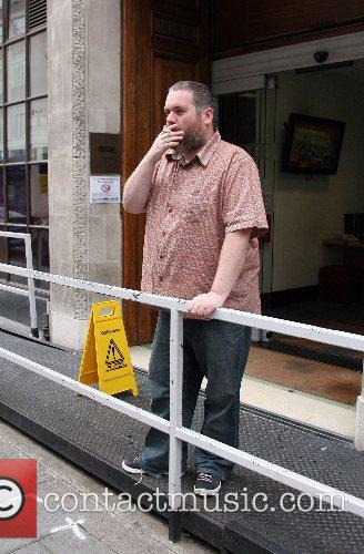 Having a cigarette before his show on BBC...