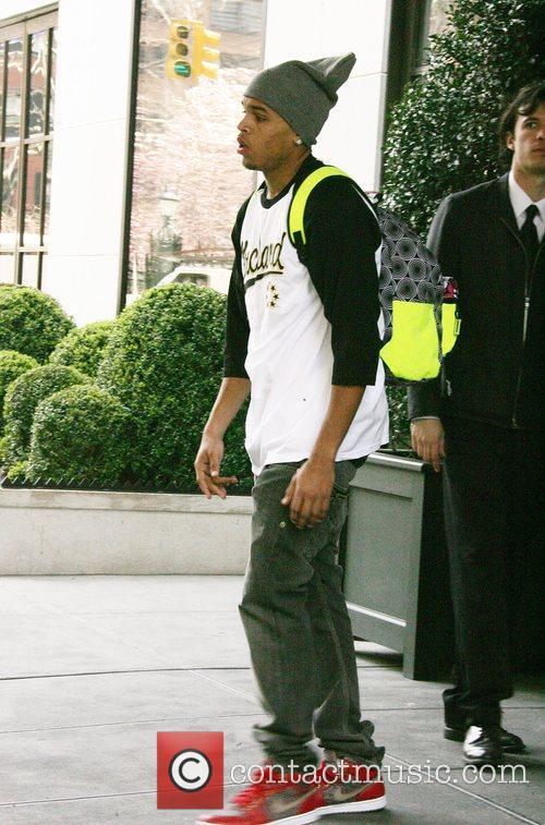 The R&B singer leaving his Manhattan hotel