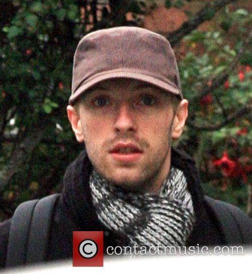 Chris Martin goes for a walk near his...