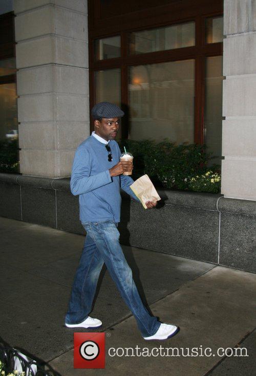 Chris Rock Chris Rock enters an office building...