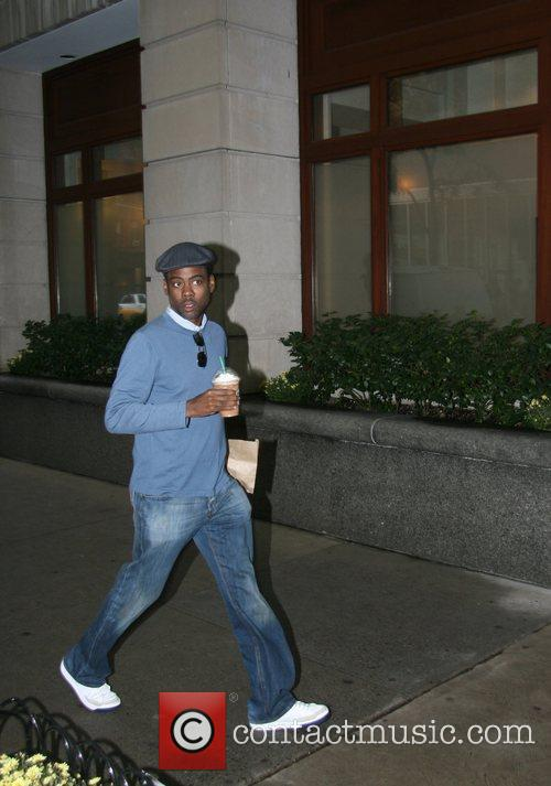 Chris Rock enters an office building