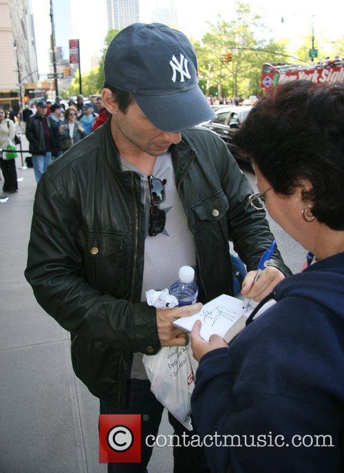 Christian Slater leaving The Ritz-Carlton hotel New York...