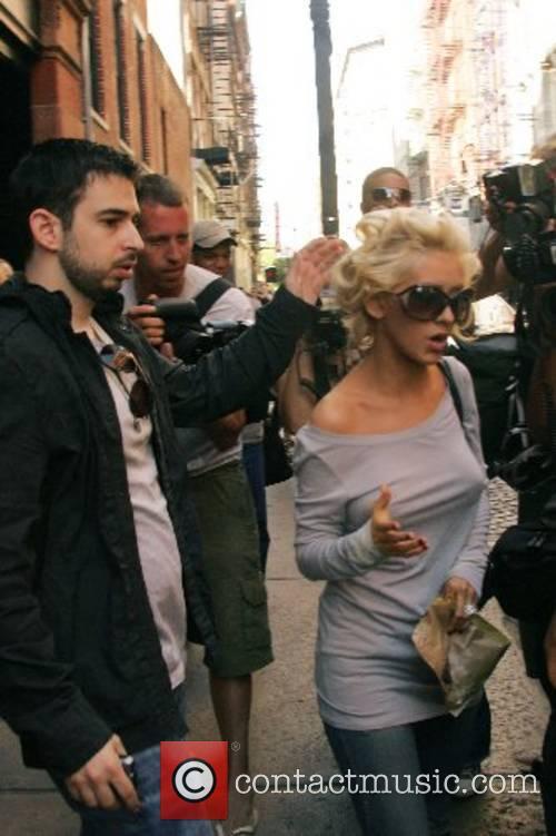 Jordan Bratman and Christina Aguilera leaving their hotel...