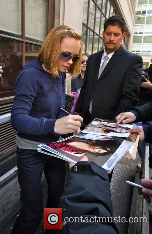 Christina Ricci signs autographs for fans as she...