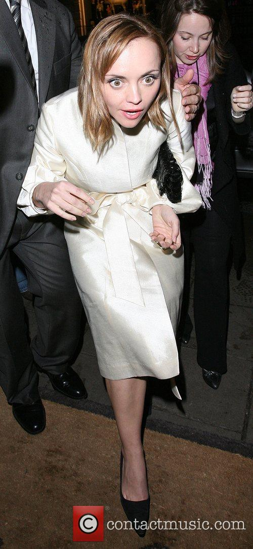Christina Ricci attempts to duck underneath a minder...