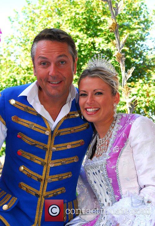 Brian Conley as 'Buttons' and Michelle Potter as...