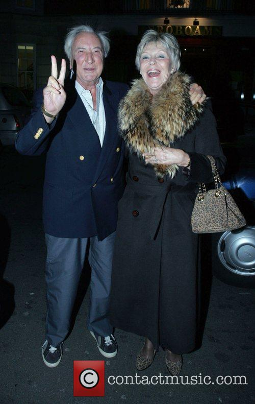 Michael Winner, His Wife Arriving At Cipriani's In Mayfair In His Phantom Rolls Royce. A Cab Would Not Move So Winner Could Park and He Promptly Gave The Cabbie The 'v' Sign. 3