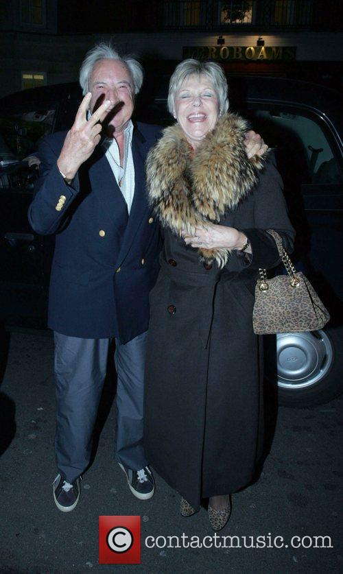 Michael Winner, His Wife Arriving At Cipriani's In Mayfair In His Phantom Rolls Royce. A Cab Would Not Move So Winner Could Park and He Promptly Gave The Cabbie The 'v' Sign. 2