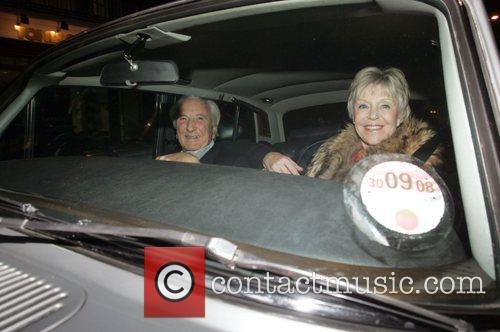 Michael Winner, His Wife Arriving At Cipriani's In Mayfair In His Phantom Rolls Royce. A Cab Would Not Move So Winner Could Park and He Promptly Gave The Cabbie The 'v' Sign. 4