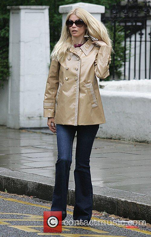 Claudia Schiffer leaving her house in the rain....
