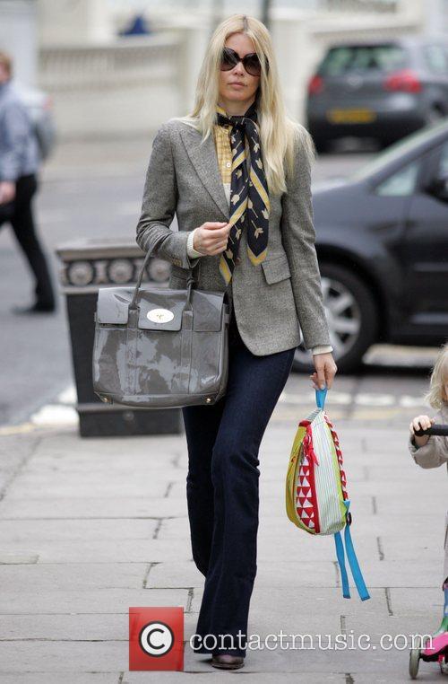 Walking her daughter Clementine to school