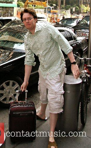 Arrives at his Manhattan hotel