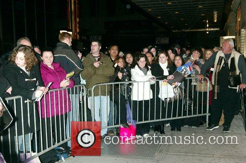 Clay Aiken greets his fans and signs autographs...