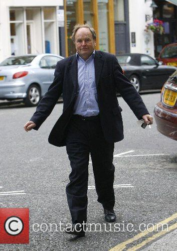 Clive Anderson out walking in Primrose Hill, pulling...