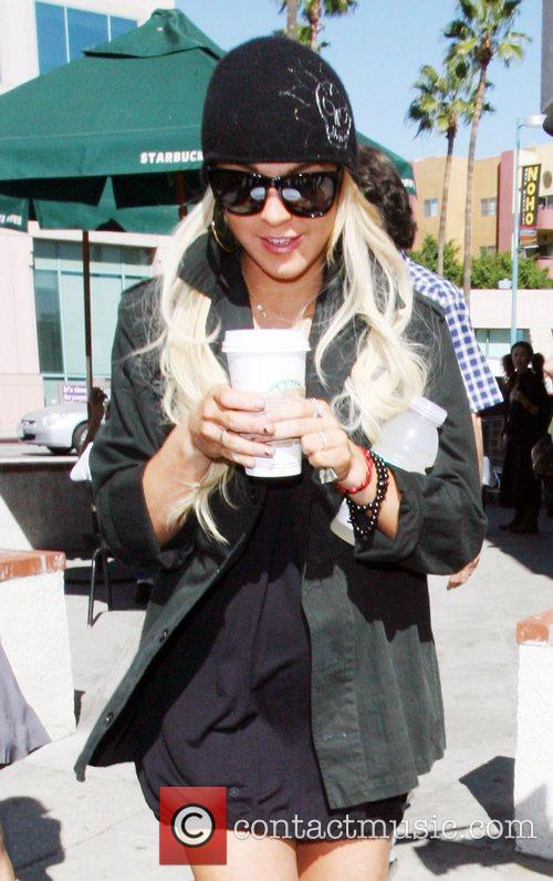 Lindsay Lohan stops at Starbucks for coffee wearing...
