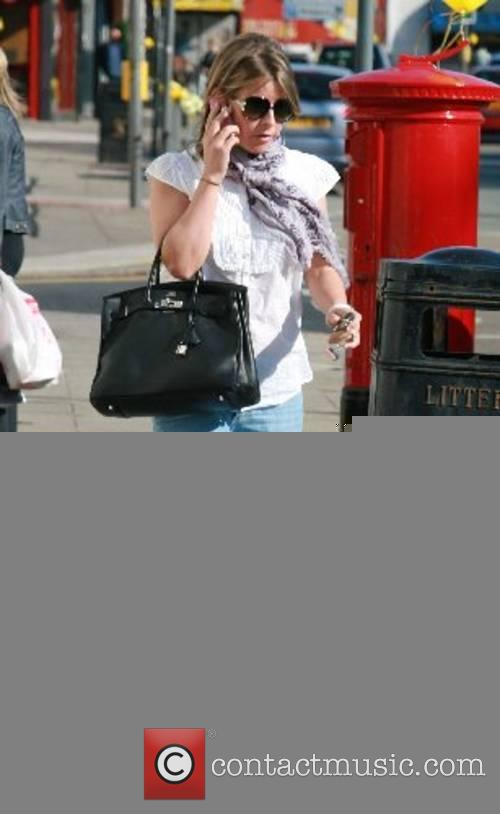 Coleen McLoughlin leaving the hairdressers whilst chatting on...