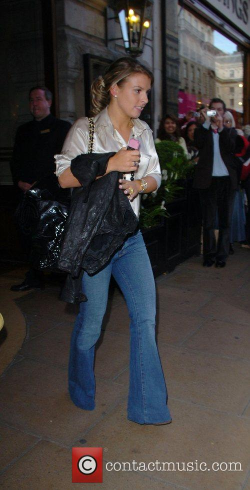 Coleen McLoughlin wearing flared jeans and a satin...