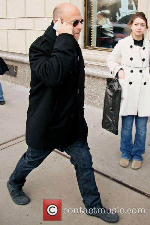 Psych actor Corbin Bernsen talks into his cellphone...