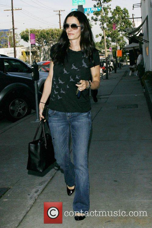 Dirt star Courteney Cox Arquette shows off a...