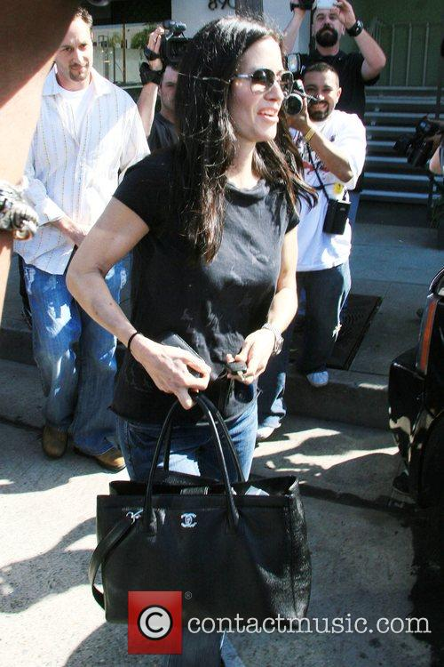 Dirt star Courteney Cox Arquette leaves Melrose Bar...